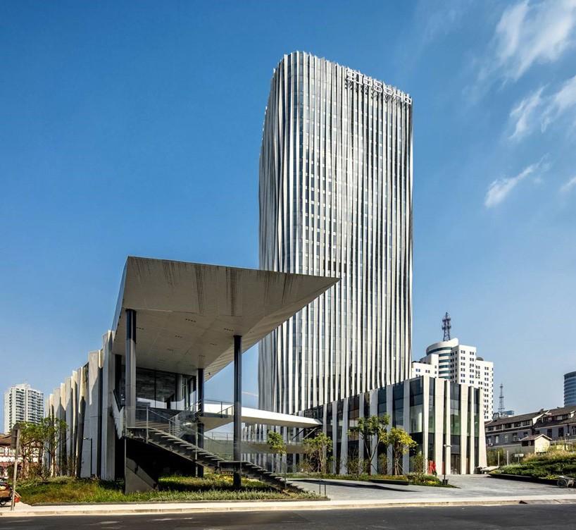 office facade. Kengo Kuma Creates A Pleated Aluminum Mesh Façade For Shanghai Office Tower Facade F